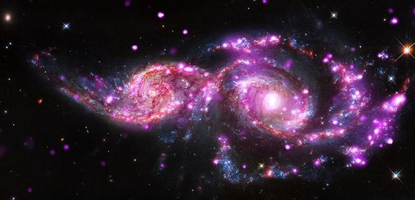 "The photo is a composite image of the spiral galaxies <a href=""http://www.nasa.gov/mission_pages/chandra/galactic-get-togethe"