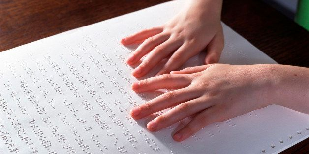 Blind child reading Braille (Photo by Universal Images Group via Getty Images)