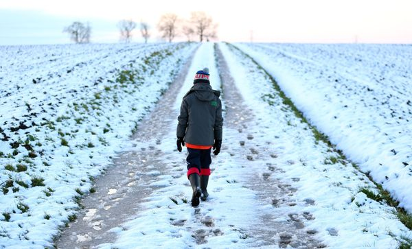8 year old James Egerton walks in the snow in Bingham, Nottinghamshire as wintry weather swept the UK, with travellers left s