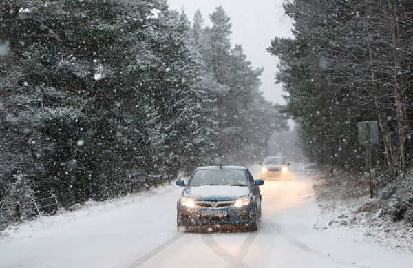 Traffic on the A93 near Braemar, Aberdeenshire, as wintry weather swept the UK, with travellers left stranded as heavy snow c