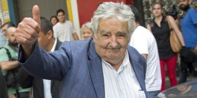 Uruguay's President Jose Mujica gives the thumb up as he leaves after delivering a press conference to present a US' Departme