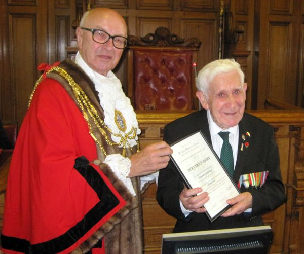 BEST QUALITY AVAILABLE Brighton and Hove mayor Brian Fitch (left) presents 90-year-old war veteran Bernard Jordan who lives a