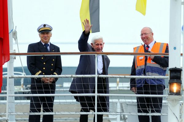 War veteran care home 'great escaper' returns to Britain. Bernard Jordan waves from the ferry alongside Captain Olivier Macoi