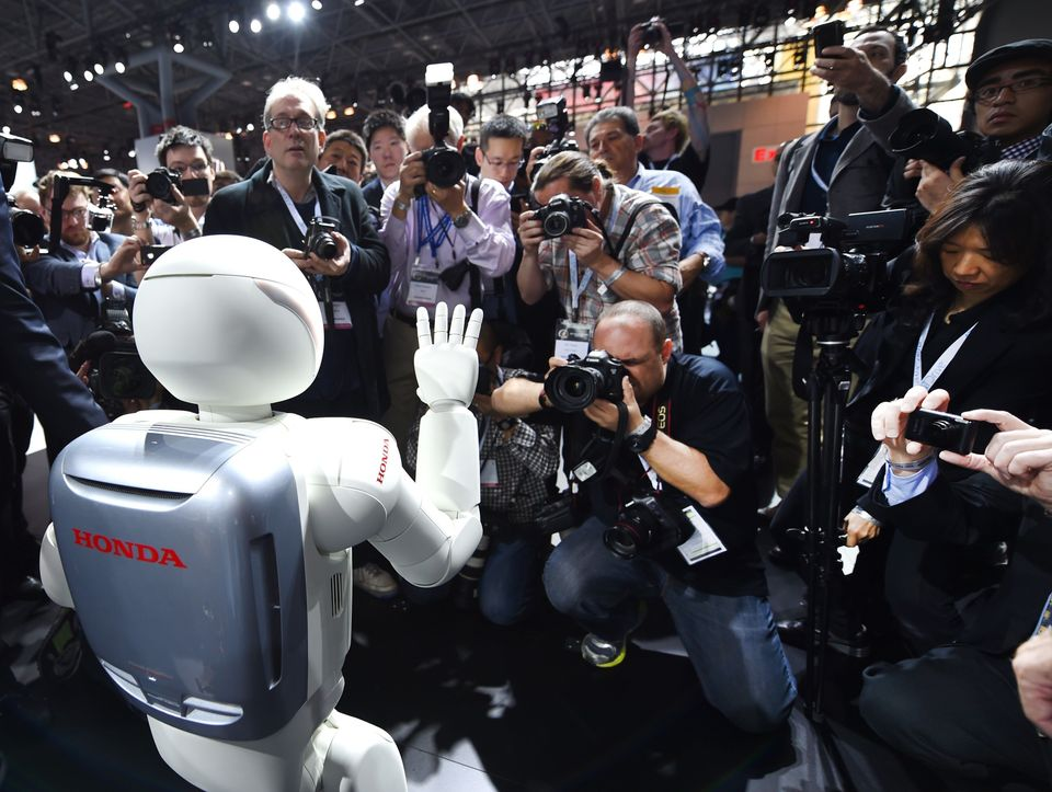 Honda North America shows off their new Asimo Robot to the media during the second press preview day at the 2014 New York Int
