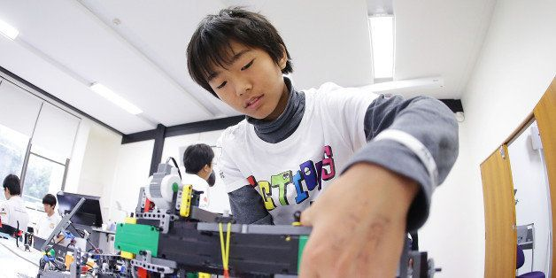 SYDNEY, AUSTRALIA - JULY 05: A child from Japan operates his robot at the LEGO Education FIRST Robot Games Tournament on July