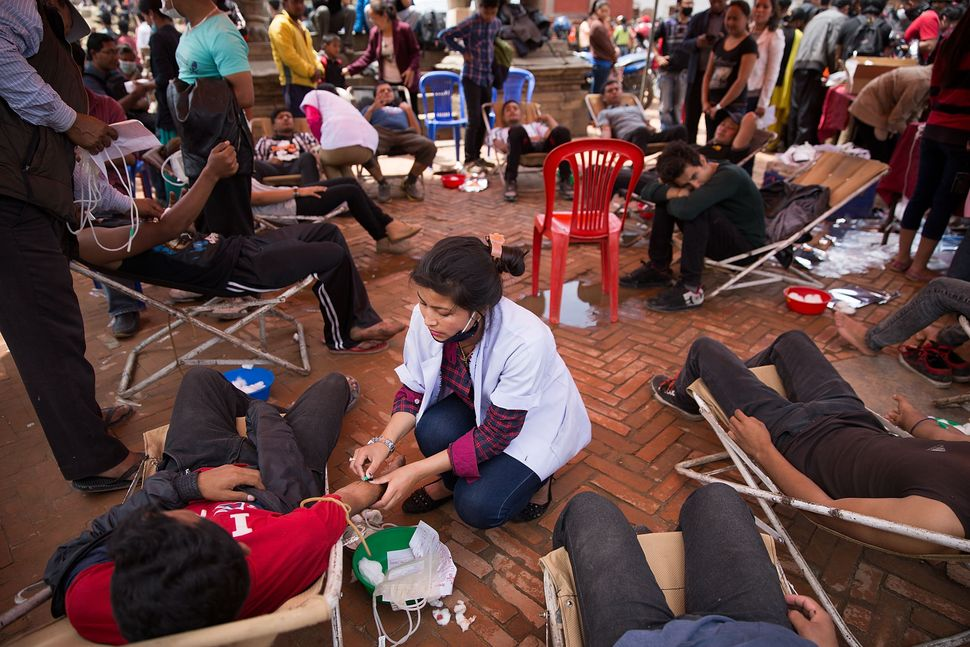 Dozens of Nepali men and women volunteer to give blood in Bhaktapur, Nepal on April 30, 2015.
