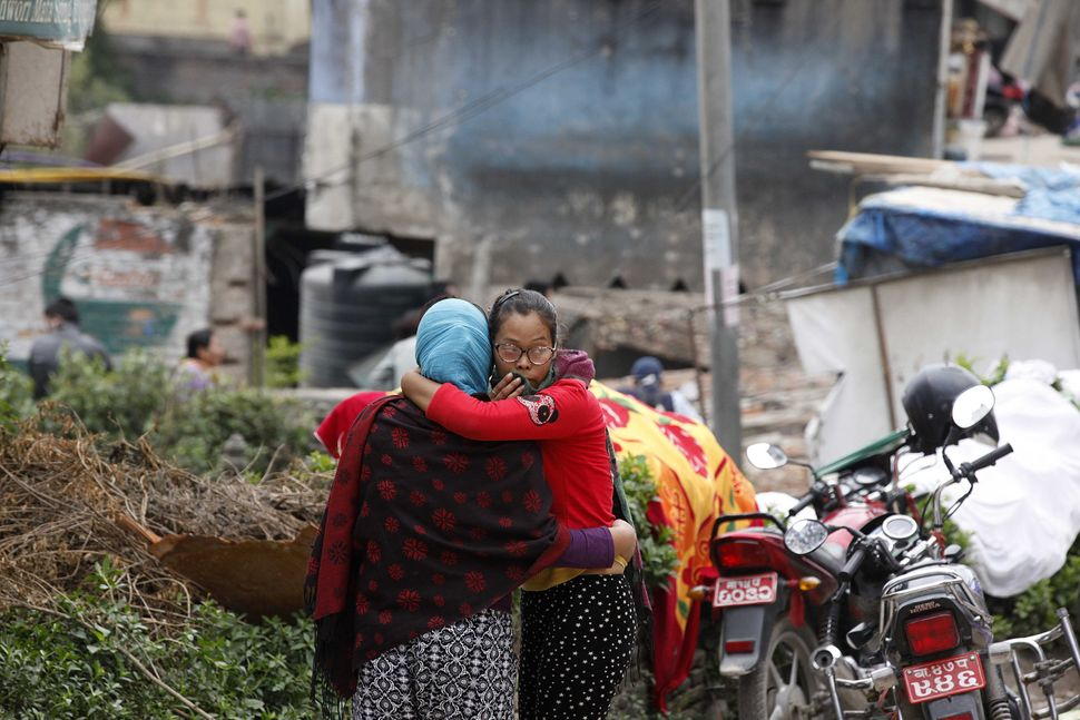 A woman whose family is still missing is comforted by a friend on April 29, 2015, in Kathmandu.