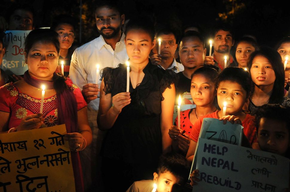 Students and community members gather for a candelight procession on April 26, 2015 in Chandigarh, India.