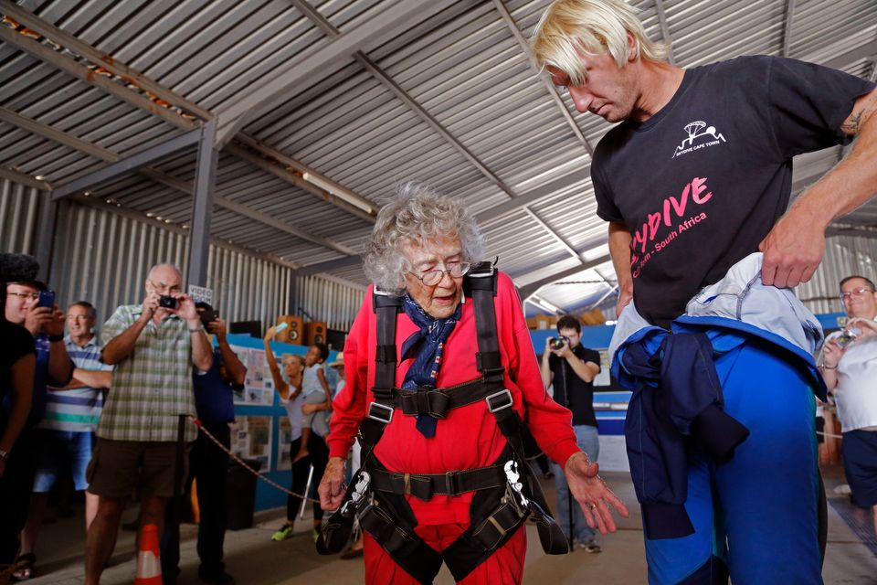 Centenarian Georgina Harwood, centre,  prepares with Jason Baker, for her tandem parachute jump forming part of her birthday