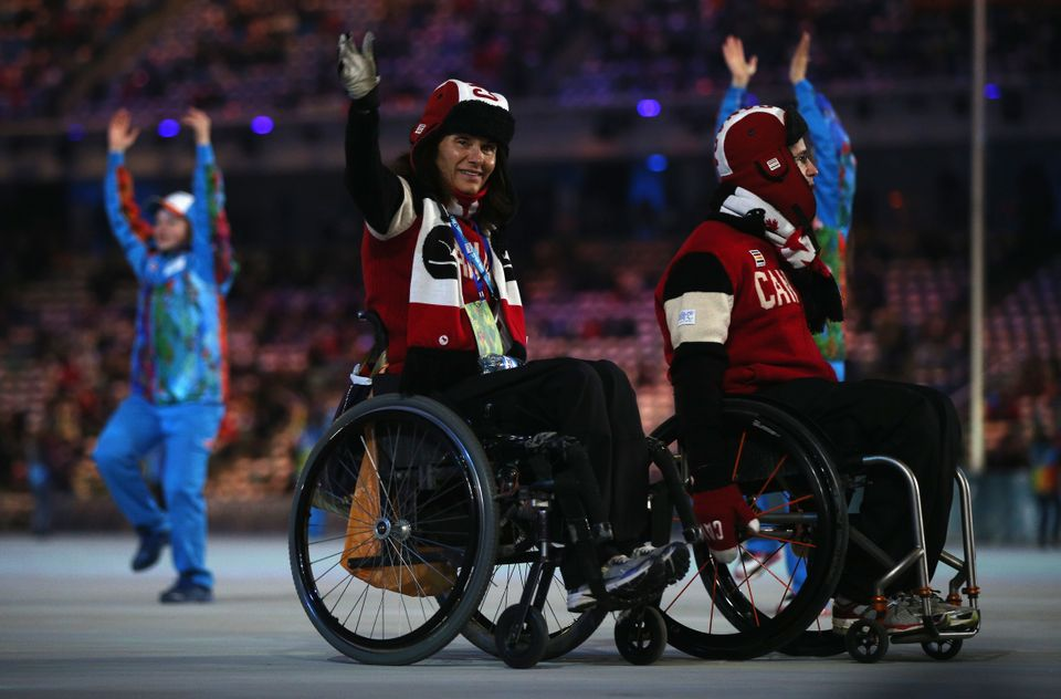 SOCHI, RUSSIA - MARCH 16:  Canada team members enter the stadium prior to the Sochi 2014 Paralympic Winter Games Closing Cere