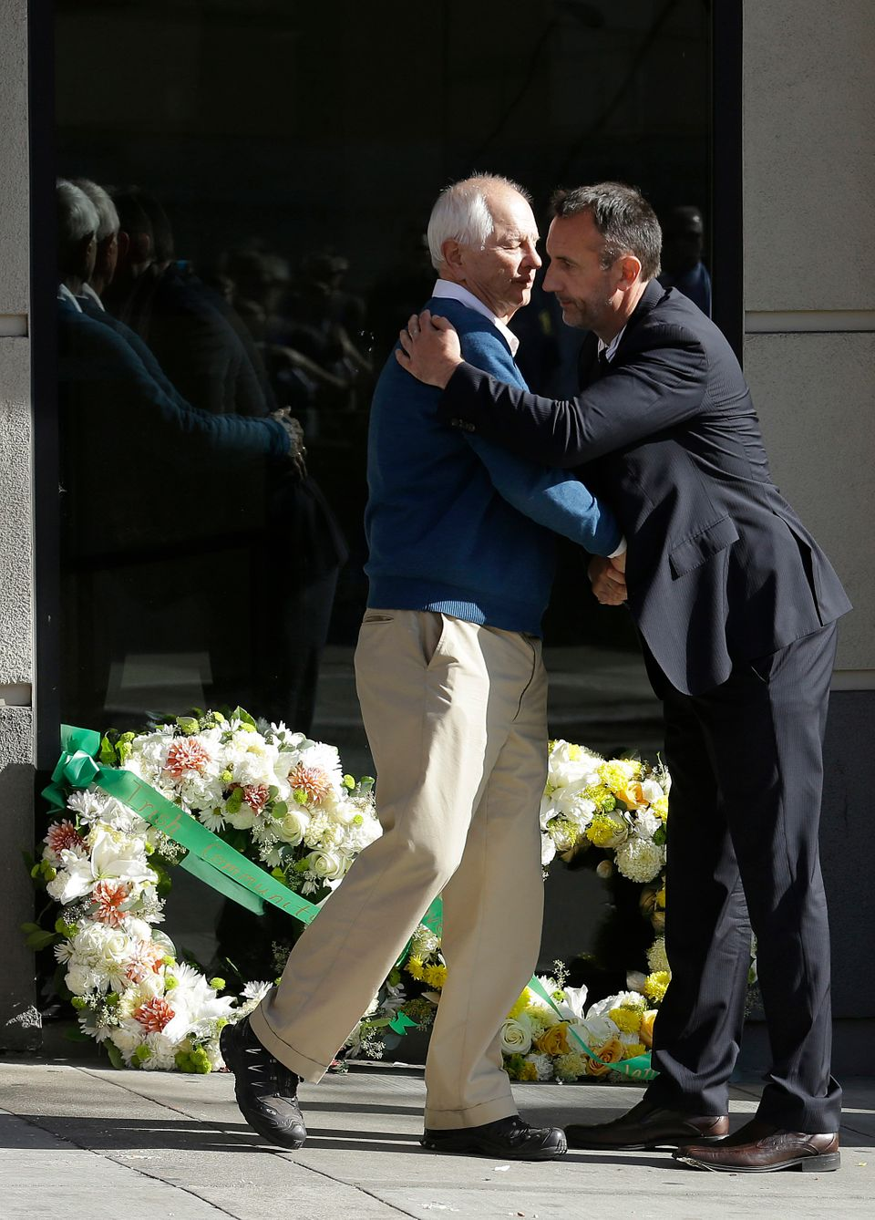 Berkeley Mayor Tom Bates, left, hugs Philip Grant, Consul General of Ireland of the Western United States, after placing wrea