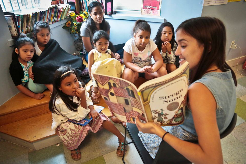 In this Wednesday, Aug. 7, 2013 photo, Sophie Mortner, foreground right, reads aloud for youngsters attending LitCamp, a summ
