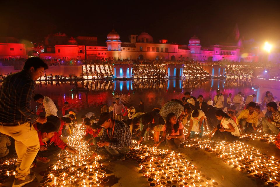 Devotees light earthen lamps on the banks of the River Sarayu as part of Diwali, the Hindu festival of lights celebrations in Ayodhya, India, India, Tuesday, Nov. 6, 2018. The northern Indian city of Ayodhya has broken a Guinness World Record after lighting 300,150 earthen lamps and keeping them lit for at least 45 minutes. (AP Photo/Rajesh Kumar Singh)