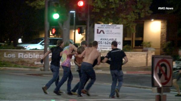 In this image taken from video, a victim is carried from the scene of the shooting Wednesday evening.