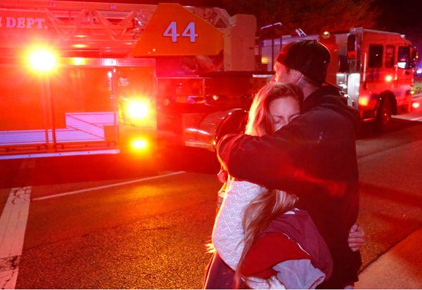 Molly Esterline is hugged by David Crawford near the scene.