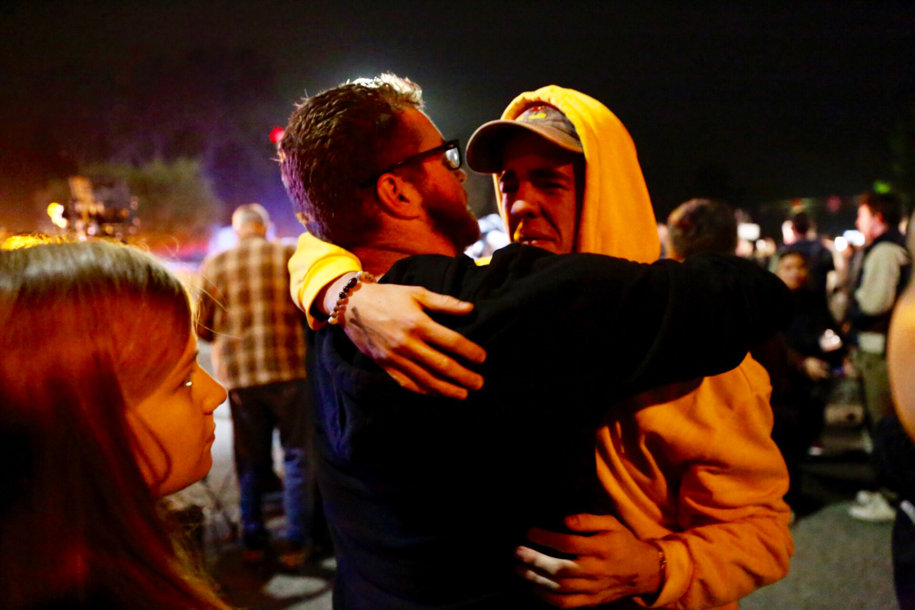 THOUSAND OAKS, CA - NOVEMBER 08: Holden Harrah, 21, (R) who witnessed the shooting hugs family and friends after a shooter wounded seven Wednesday night on November 8, 2018 in Thousand Oaks, California. The gunman burst into the bar around 11:20 p.m., cloaked in all black as he threw smoke bombs and began shooting at targets as young as 18 inside the Borderline Bar & Grill, authorities and witnesses said. (Photo by Al Seib / Los Angeles Times via Getty Images)