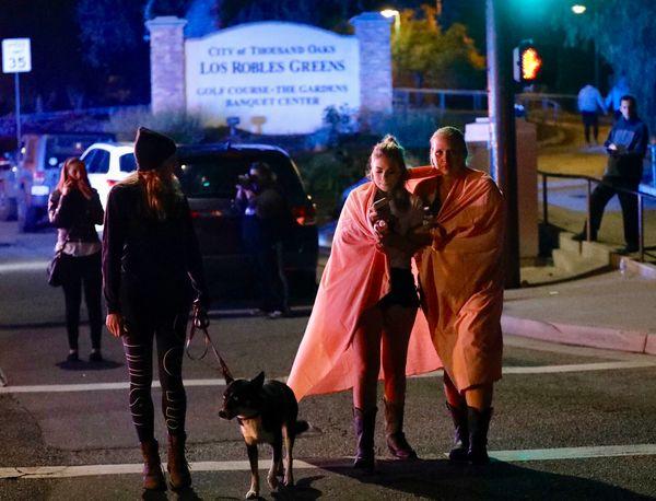 People leave the scene in Thousand Oaks.