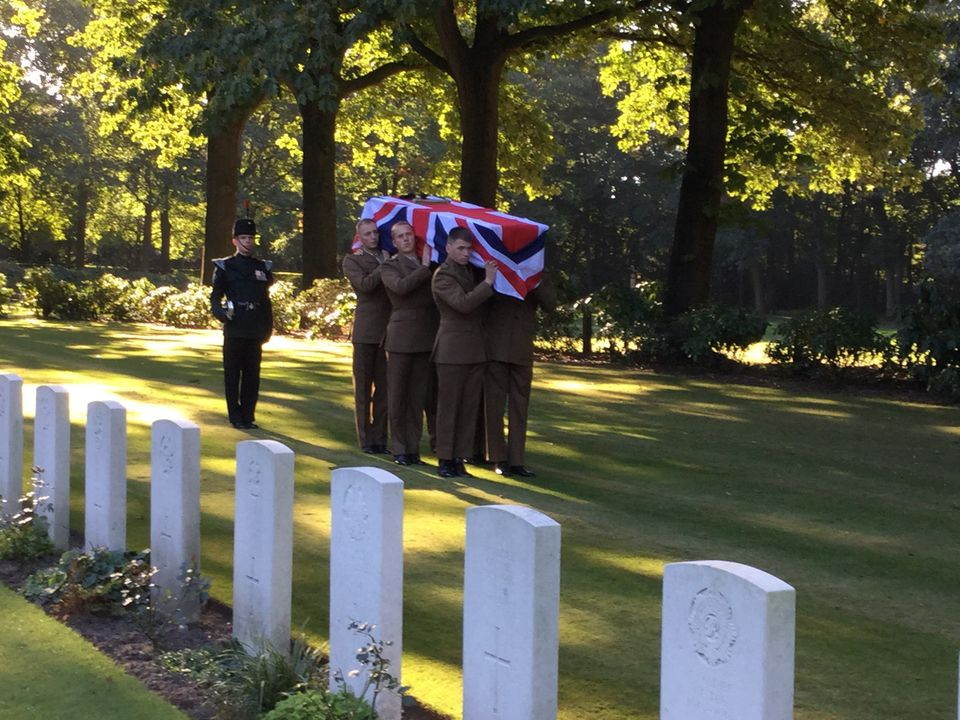 A photo of Lance Corporal Donald Noble's coffin being carried into Arnhem Oosterbeek War Cemetery by...