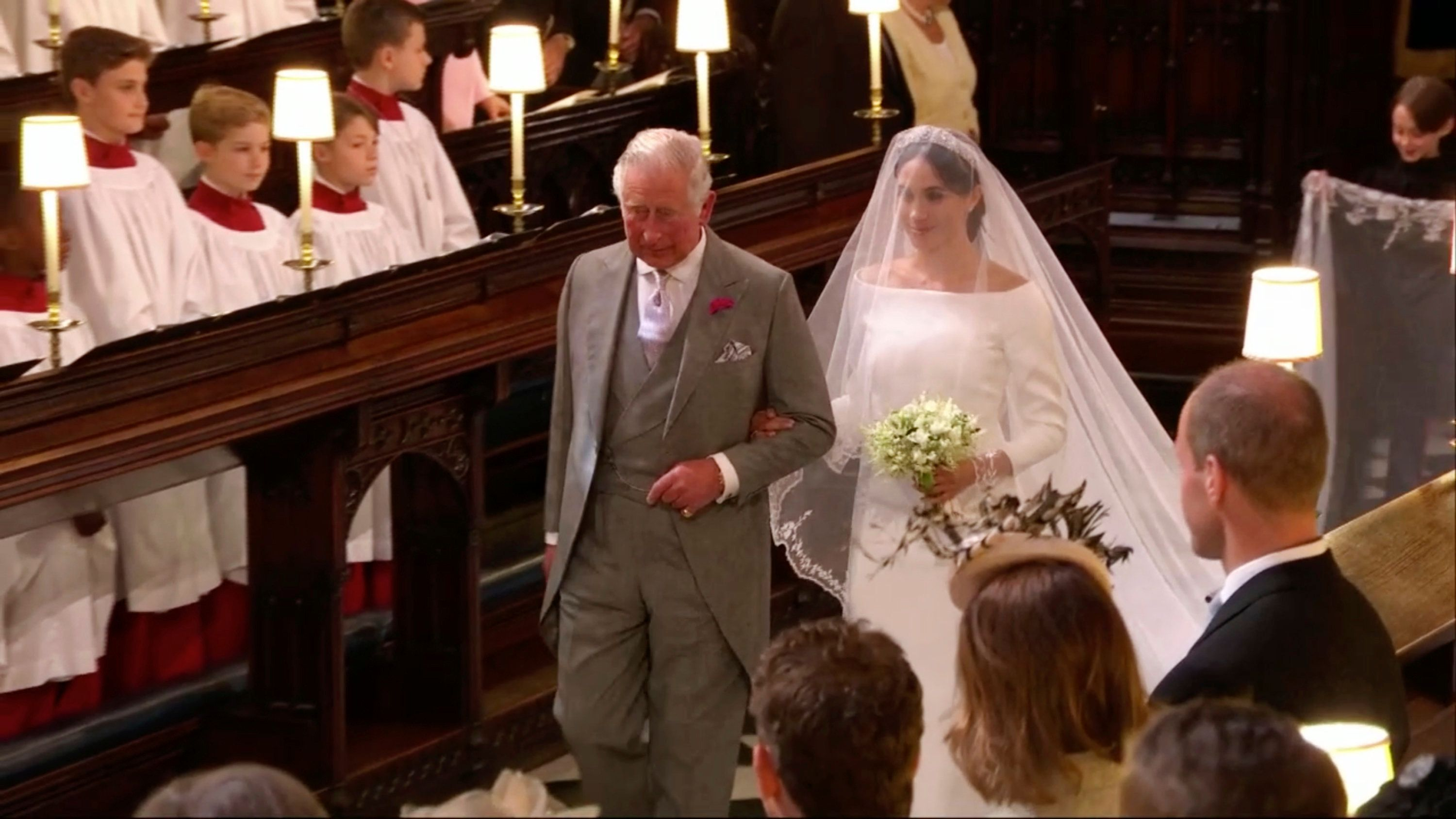 In this frame from video, Meghan Markle walks down the aisle with Prince Charles for her wedding ceremony at St. George's Chapel in Windsor Castle in Windsor, near London, England, Saturday, May 19, 2018.  (UK Pool/Sky News via AP)