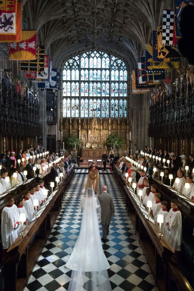 Meghan Markle and Prince Charles, Prince of Wales, walks down the aisle toward her husband-to-be, Britain's Prince Harry, Duke of Sussex, in St George's Chapel, Windsor Castle.