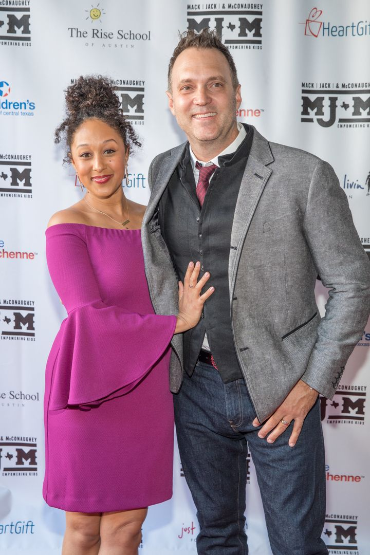 Tamera Mowry-Housley and husband Adam Housley pictured together.