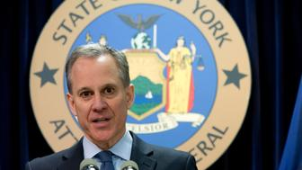 """FILE - In this Feb. 11, 2016, file photo, New York Attorney General Eric T. Schneiderman speaks during a news conference in New York. The prosecutor appointed to investigate allegations that former New York Attorney General Schneiderman physically abused women says she has closed the case without bringing criminal charges, Thursday, Nov. 8, 2018. Schneiderman said in a statement he didn't consider the decision an exoneration. He also apologized """"for any and all pain that I have caused."""" (AP Photo/Mary Altaffer, File)"""
