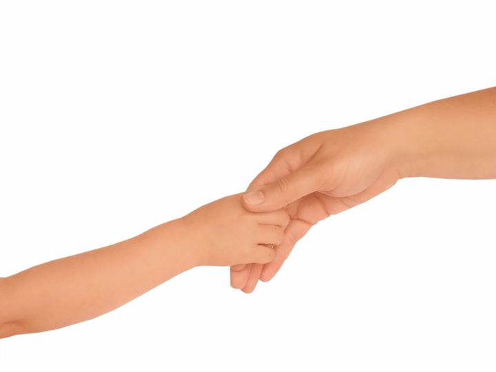 Adult and child hold hands
