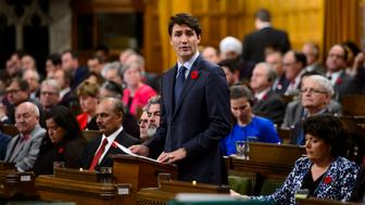 Canadian Prime Minister Justin Trudeau delivers a formal apology on behalf of his nation for turning away a ship full of Jewish refugees trying to flee Nazi Germany in 1939 in the House of Commons on Parliament Hill in Ottawa, Ontario on Wednesday, Nov. 7, 2018. The German liner was carrying 907 German Jews fleeing Nazi persecution and it also had been rejected by Cuba and the United States. (Sean Kilpatrick/The Canadian Press via AP)