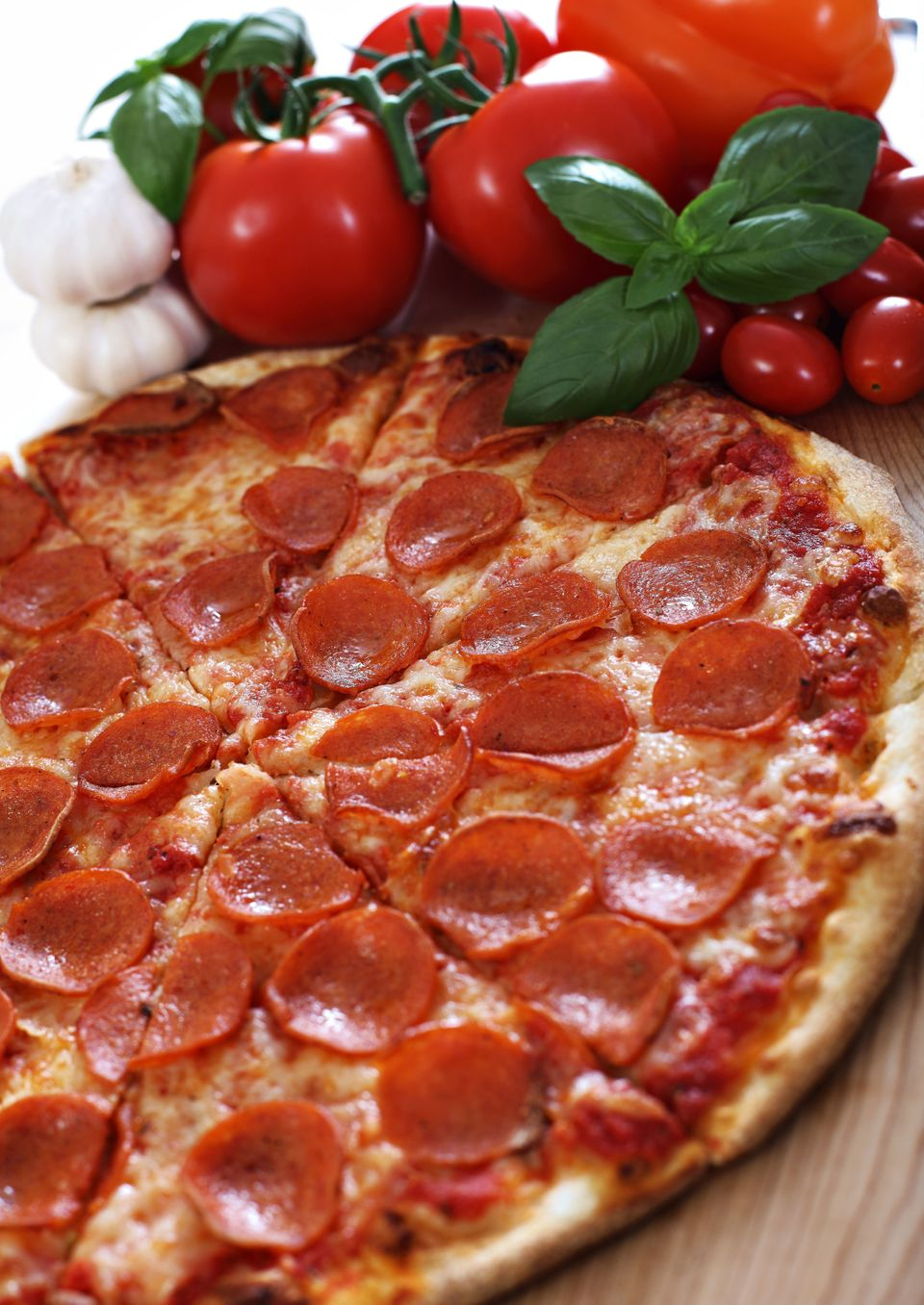 The calories in pizza add up dramatically, especially if you have more than one slice. One way to feel full with fewer slices