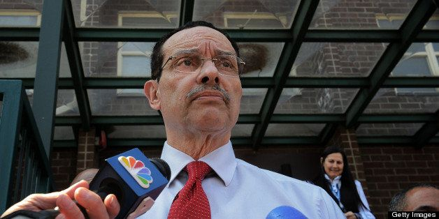 WASHINGTON, DC - APRIL 5: Mayor Vincent Gray talks to reporters after he visits Tyler House, site of last months' drive by sh