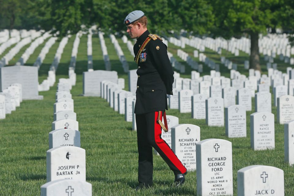 England's Prince Harry visits Section 60 at Arlington National Cemetery, Friday, May 10, 2013. The British soldier-prince is