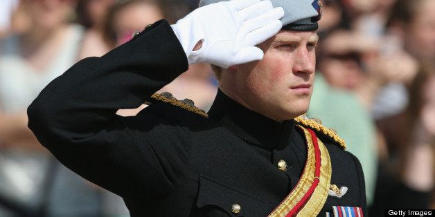 ARLINGTON, VA - MAY 10:  HRH Prince Harry wearing his No. 1 ceremonial uniform of The Blues and Royals salutes as he pays his
