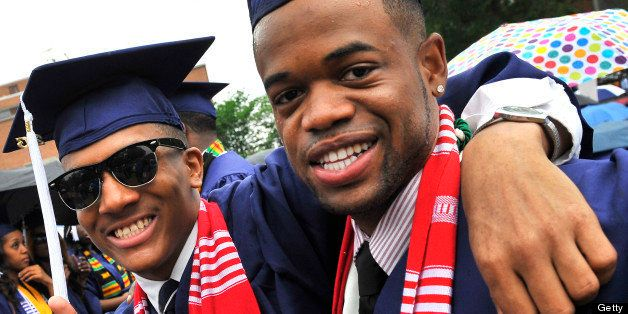 WASHINGTON, DC - MAY 11, 2013: Howard University graduates Nick Sneed(L) and Julian Lewis (R) enjoy the moment before the sta