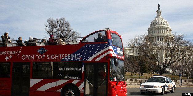 WASHINGTON, DC - FEBRUARY 17: A tourist bus drives past the U.S. Capitol building, on February 17, 2012 in Washington, DC. Ea