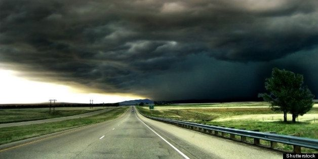 highway leading into a storm on ...