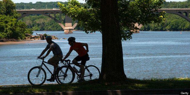 WASHINGTON, DC - JUNE 4: Bikers make their way along the Potomac River on the Rock Creek path near the Kennedy Center Tuesday