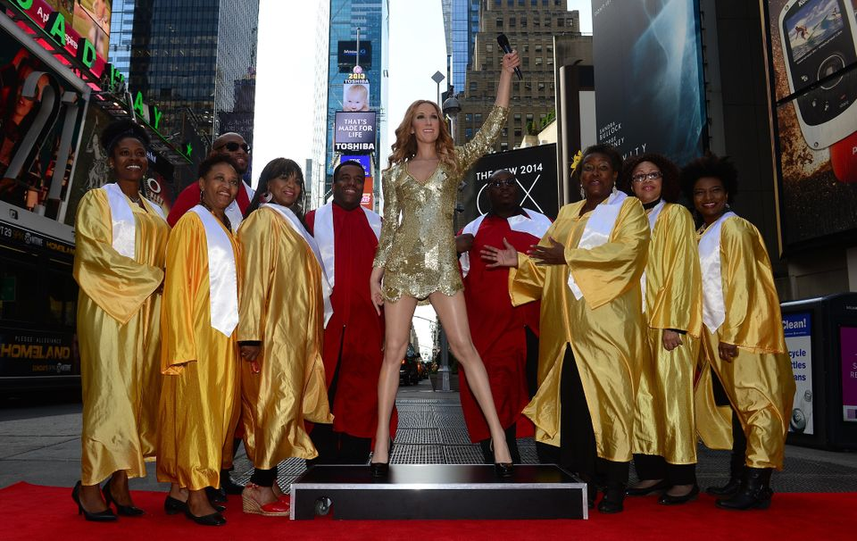 A wax figure of Canadian singer Celine Dion is unveiled with a real backup choir by Madame Tussauds New York, at the heart of