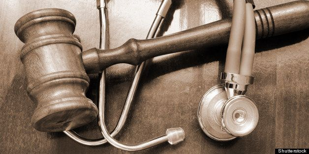 gavel and stethoscope on wooden ...