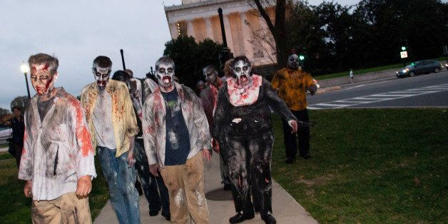 WASHINGTON - OCTOBER 26: Zombies walk the streets during the Worldwide Zombie Invasion at Lincoln Memorial on October 26, 201