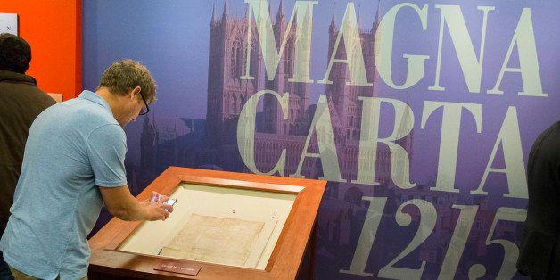 Visitors tour the Library of Congress new exhibit, Magna Carta: Muse and Mentor, Thursday, Nov. 6, 2014, in Washington. Brita