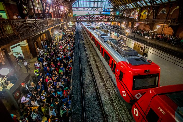 Passengers at a train station in Brazil.
