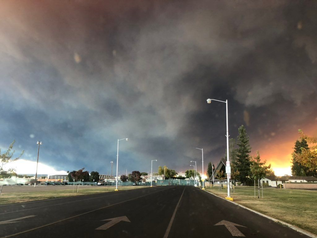 Officials in Butte County, California, urged residents to evacuate on Thursday as a rapidly growing fire threatened several communities.