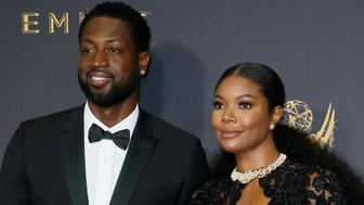 Dwyane Wade, left, and Gabrielle Union arrive at the 69th Primetime Emmy Awards on Sunday, Sept. 17, 2017, at the Microsoft Theater in Los Angeles. (Photo by Danny Moloshok/Invision for the Television Academy/AP Images)