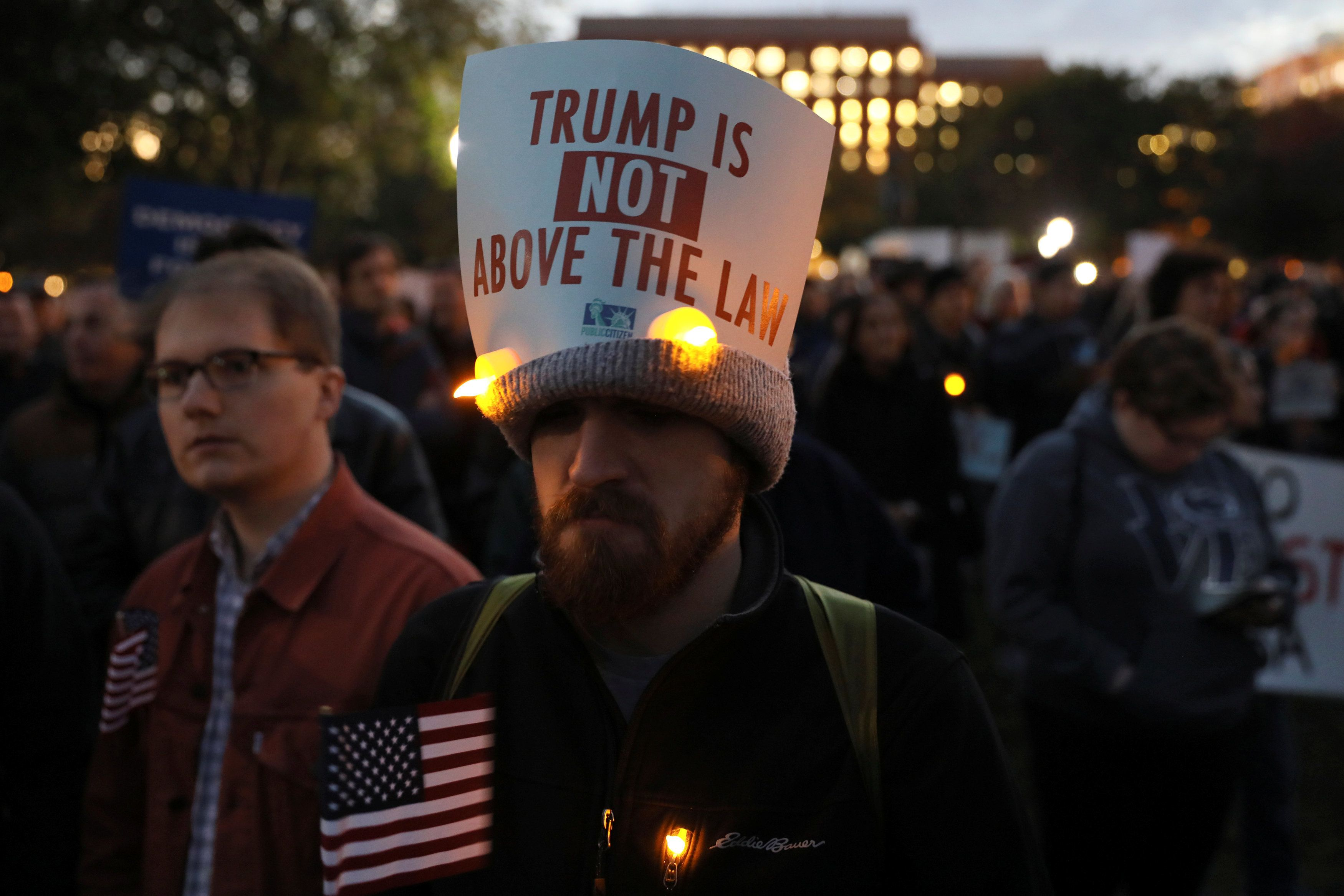 Protesters rally to demand the U.S. government to protect the investigation led by Special Counsel Robert Mueller into alleged Russian meddling in the 2016 Trump campaign, outside the White House in Washington, U.S. November 8, 2018. REUTERS/Jonathan Ernst