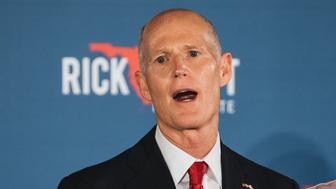 Senator-elect Rick Scott, governor of Florida, speaks to attendees during an election night rally in Naples, Florida, U.S., on Tuesday, Nov. 6, 2018. Republicans retained control of the Senate after GOP candidates unseated incumbent Democrats in Indiana and North Dakota and won an open seat in Tennessee. Photographer: Jayme Gershen/Bloomberg via Getty Images