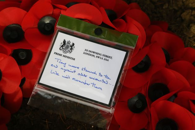 Prime Minister Theresa May left tributes at the graves of the fallen