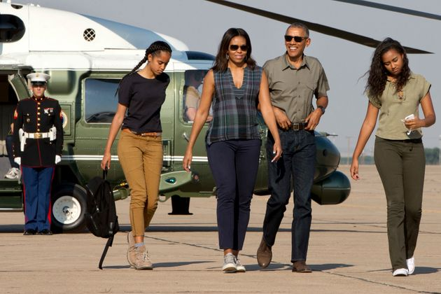 The Obamas, pictured with their daughters Sasha and Malia two years