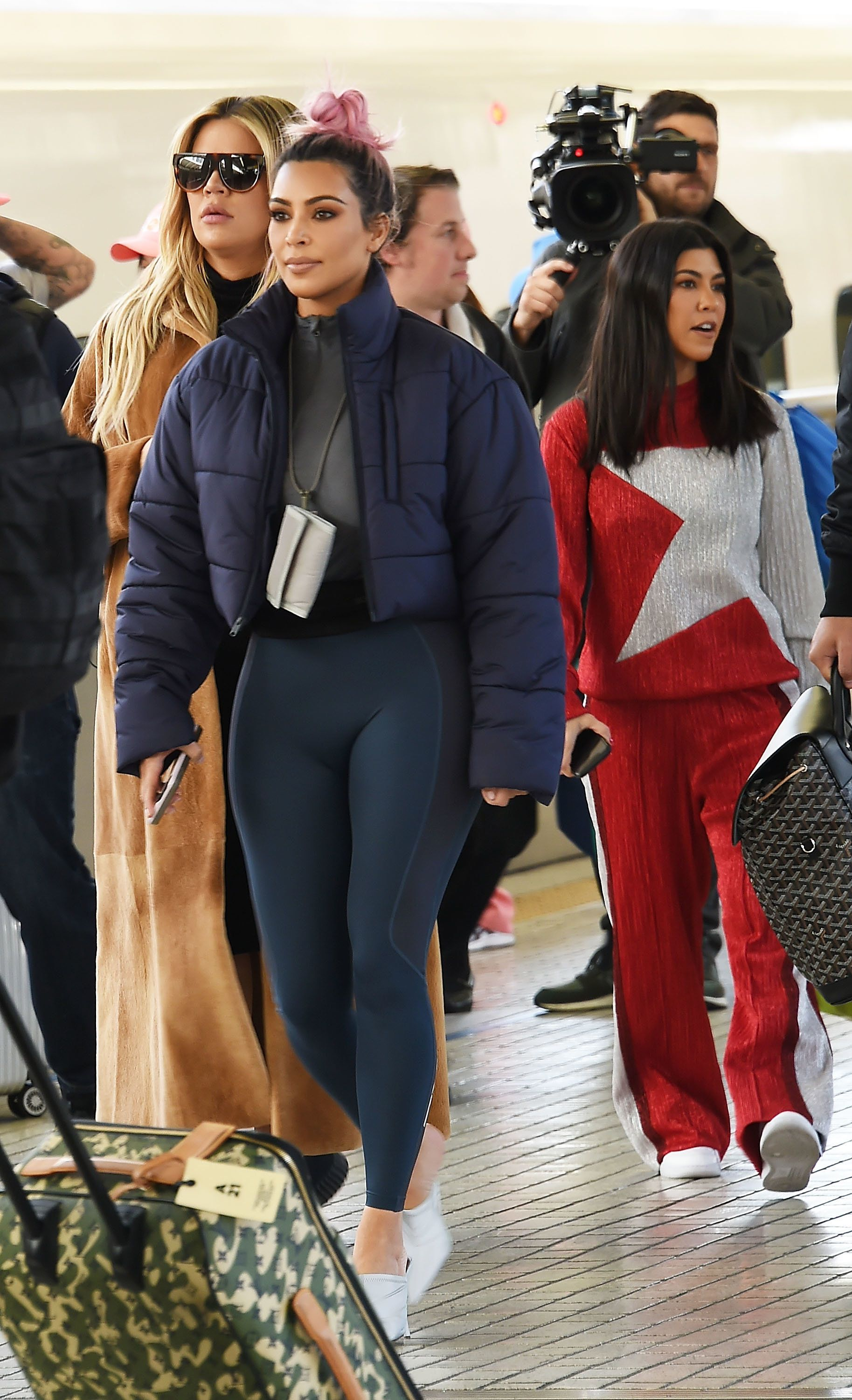 TOKYO, JAPAN - MARCH 02:  Kim Kardashian, Kourtney Kardashian and Khloe Kardashian are seen upon arrival at Tokyo Station on March 2, 2018 in Tokyo, Japan.  (Photo by Jun Sato/GC Images)