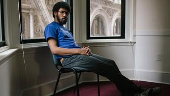 Johnathan Hamilton, 21, sits for a portrait in the offices of the Juvenile Law Center in Philadelphia, Pennsylvania on Monday, September 17, 2018. Hamilton, who experienced a lack of academic structure in the foster care system growing up, is now a a freshman at Cabrini College. Young people in foster care across the country are sent to juvenile residential centers that end up derailing their academic path, rather than help it along.  (Michelle Gustafson for The Huffington Post)