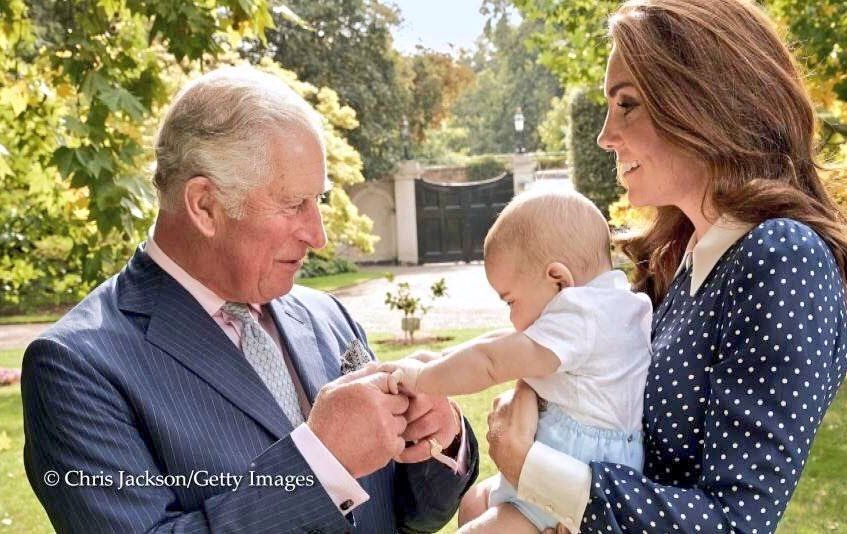 Prince Charles, Prince Louis and the Duchess of Cambridge.